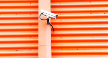 security camera on orange wall