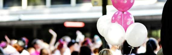 pink balloons at rally
