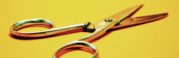 metal scissors on yellow