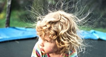kid with electrostatic hair