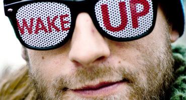 "man wears ""wake up"" glasses"