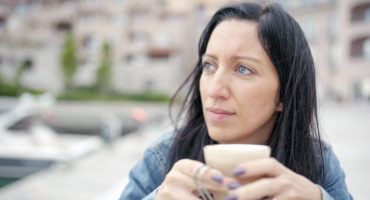 serious woman drinking coffee