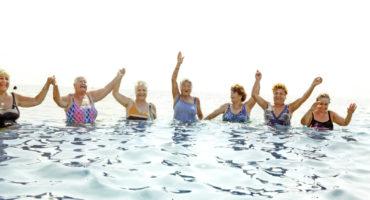women swim in ocean