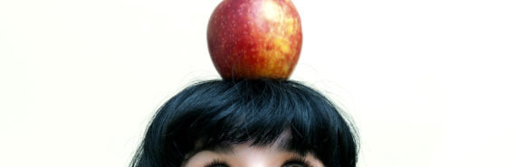 apple on a woman's head