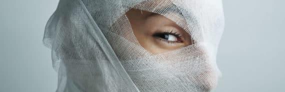 bandaged face