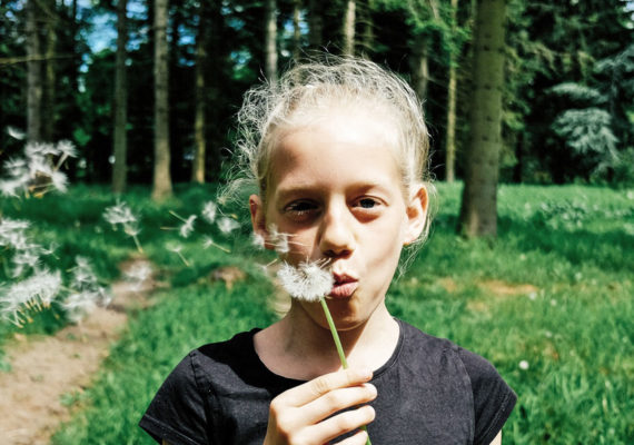girl with dandelion outdoors