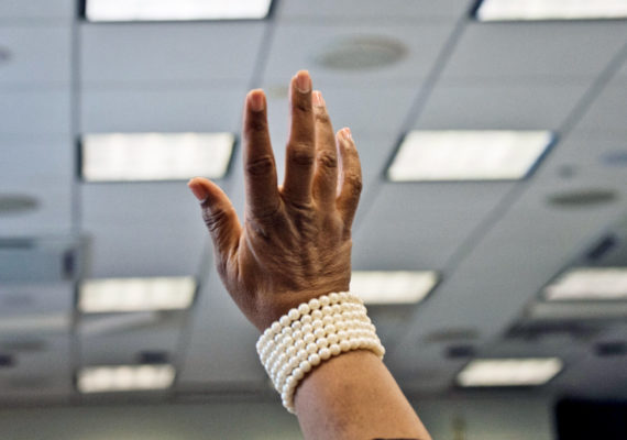 raised hand with pearl bracelet