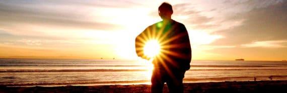 man pretends to hold sun