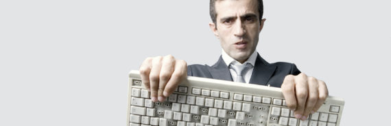 man holds a broken keyboard