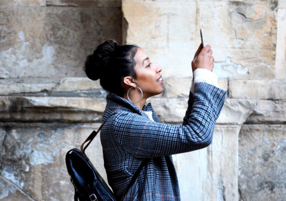 woman looks into phone