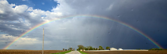 rainbow over rural highway