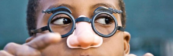 boy in glasses with nose