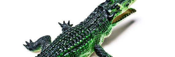 toy crocodile on white