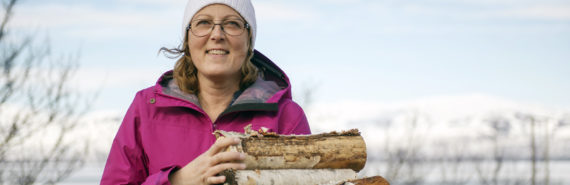 woman holds firewood