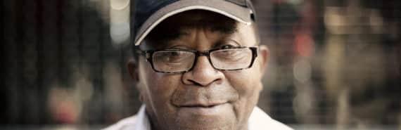 older man wears Yankees hat