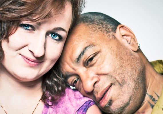 man leans on woman's shoulder