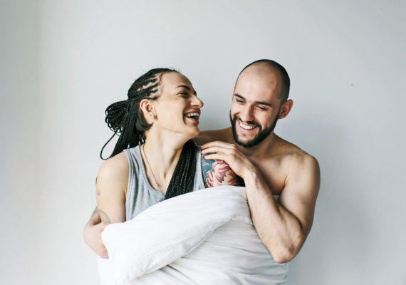 couple laughing in blanket