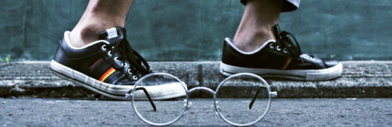sneakers and glasses by curb