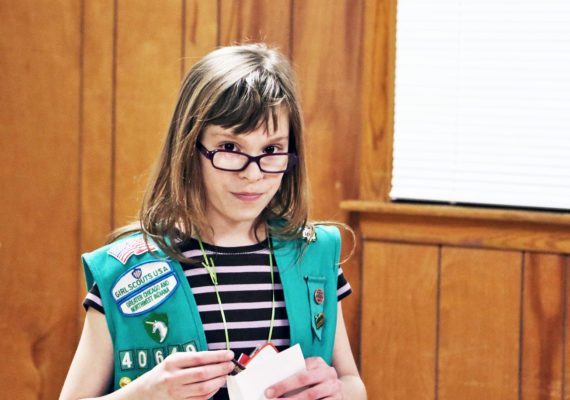 girl in girl scouts vest
