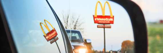 McDonald's sign reflected in car mirror