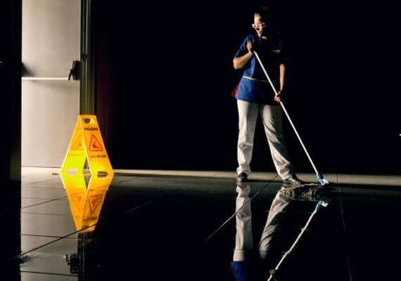 woman mops floor