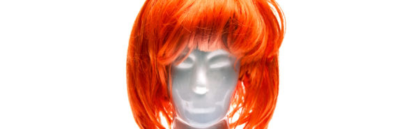 mannequin head in orange wig