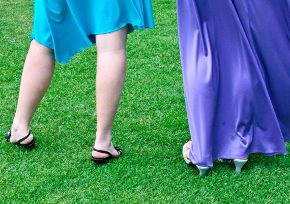 two girls in prom dresses