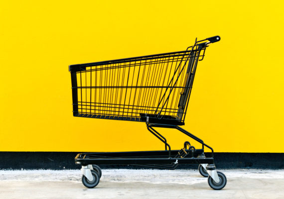 shopping cart and yellow wall