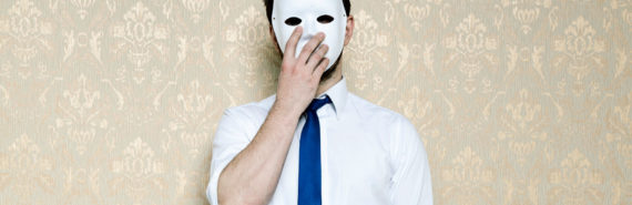 man in tie wears mask