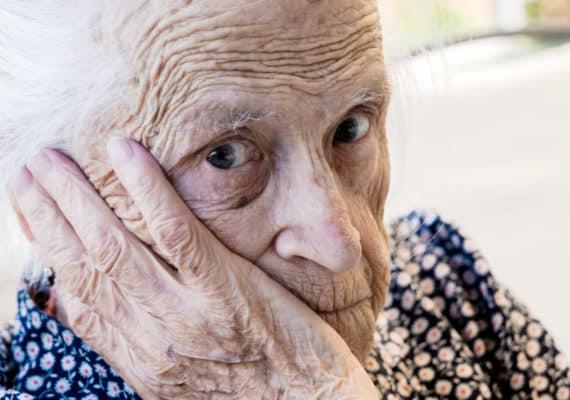 elderly woman looks worried