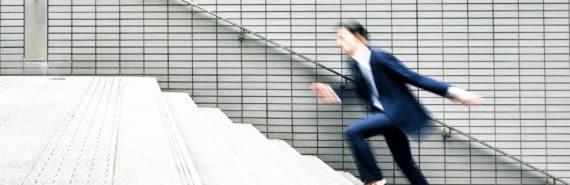 businessman runs up stairs