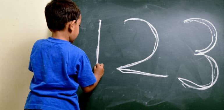 child writes numbers