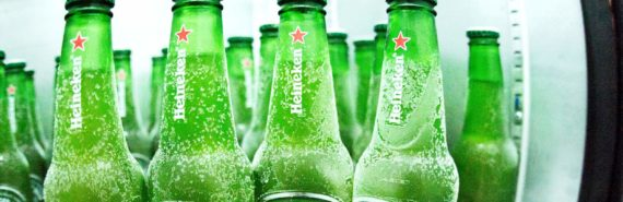 green Heineken bottles in fridge