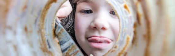 kid's face through peanut butter jar
