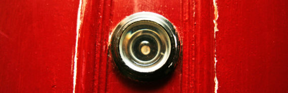 peephole in red door