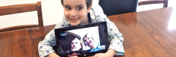 kid with grandparents via skype
