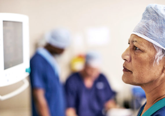 surgeon looks at monitor