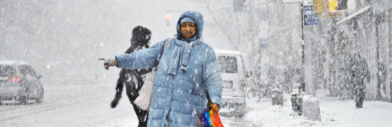 woman hails cab in snow storm
