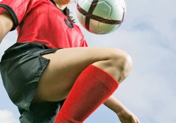 soccer player knees ball