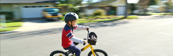 boy rides bike in neighborhood
