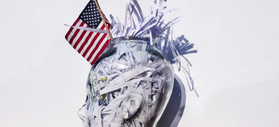 glass head with papers and flag