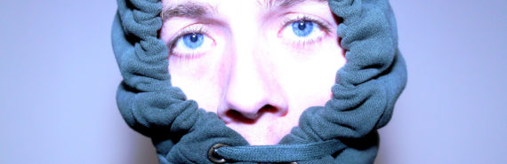 man wears a blue hoodie