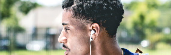 young guy with earbuds