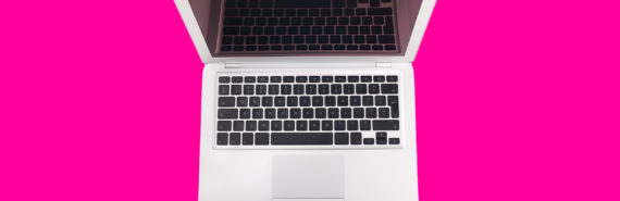 laptop on pink background