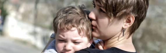 mom comforts boy