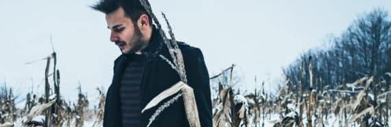 man in snowy corn field