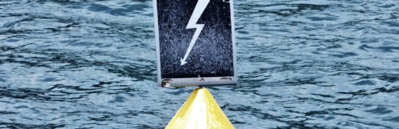 lightning symbol on buoy in water