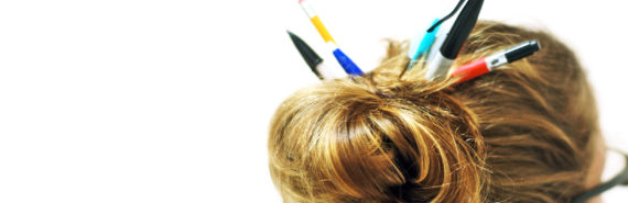 pens and pencils in hair