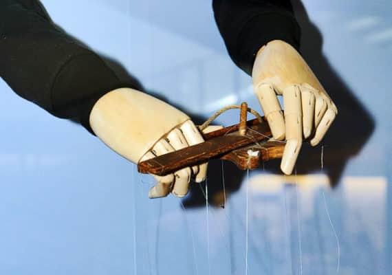 sculpture of puppet master hands
