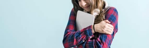 woman hugs tablet